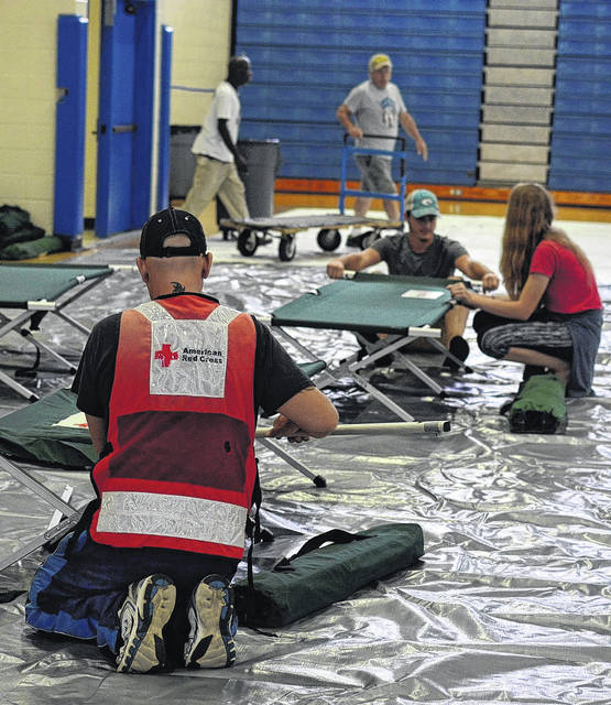 Six local Red Cross volunteers provide Tropical Storm Florence disaster relief