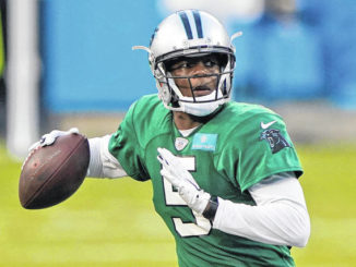 FILE - In this Aug. 26, 2020, file photo, Carolina Panthers quarterback Teddy Bridgewater throws a pass during NFL football practice in Charlotte, N.C. Four years ago the quarterback suffered a torn ACL and fractured kneecap which left his budding NFL career in serious doubt.                                  Chris Carlson | AP File Photo