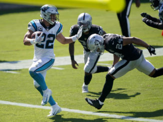 Carolina Panthers running back Christian McCaffrey scores ahead of Las Vegas Raiders safety Johnathan Abram during the second half of an NFL football game Sunday, Sept. 13, 2020, in Charlotte, N.C.                                  Brian Blanco | AP Photo