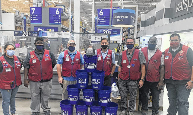 Katelin Gandee | The Laurinburg Exchange                                 Lowe's donated buckets filled with hand sanitizer, masks, gloves, a hat and DIY kit to children battling cancer. The drive is being held by The Laurinburg Exchange and the community is asked to bring in items for children who are currently fighting cancer.