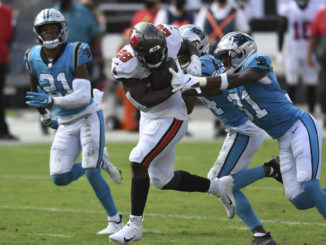 Tampa Bay Buccaneers running back Leonard Fournette (28) is stopped by Carolina Panthers strong safety Juston Burris (31) during the second half of an NFL football game Sunday, Sept. 20, 2020, in Tampa, Fla.                                  Jason Behnken | AP Photo