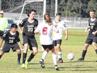 Scotland Christian Academy players (left-to-right) Edwin Jaimes, Benton Chaput and Tyler Myers defend a shot by Mintz forward Emmerson Smith Friday afternoon.                                  Neel Madhavan | Laurinburg Exchange