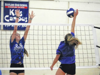The Lady Scots work on kills and blocking drills during a practice at Scotland High School Nov. 10, 2020.                                  Neel Madhavan | Daily Journal