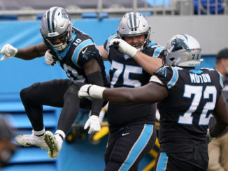 Carolina Panthers wide receiver Curtis Samuel, left, celebrates after scoring with Michael Schofield and Taylor Moton during the second half of an NFL football game against the Detroit Lions Sunday, Nov. 22, 2020, in Charlotte, N.C.                                  Brian Blanco | AP Photo