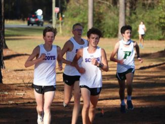 Senior Jennings Dean, senior Drew Hamilton and junior Cooper Sutherland run during the first lap at the course at the James L. Morgan Recreation Complex during Wednesday's cross country meet.                                  Neel Madhavan | The Laurinburg Exchange