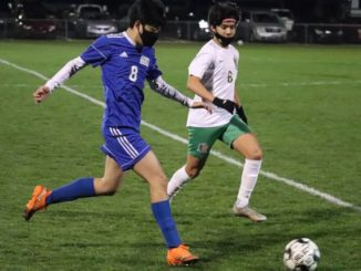 Scotland's Hiroto Inamura (8) and Richmond's Alex Medina (6) jostle for the ball during Wednesday's game.                                  Neel Madhavan | Daily Journal and Laurinburg Exchange