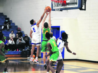 Richmond's Dylan Lewis (4) and Scotland's Patrick Reaves (5) go up for a rebound during a game earlier this season.                                  Neel Madhavan | Laurinburg Exchange File Photo