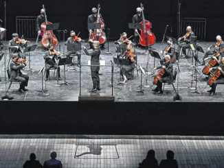 The Associated Press                                 Esa-Pekka Salonen, center, music director of the San Francisco Symphony and principal conductor of London's Philharmonia Orchestra, leads the New York Philharmonic before an audience of 150 concertgoers at The Shed in Hudson Yards, Wednesday in New York. It was the first time since March 10, 2020, that the entire orchestra performed together in front of a live audience.