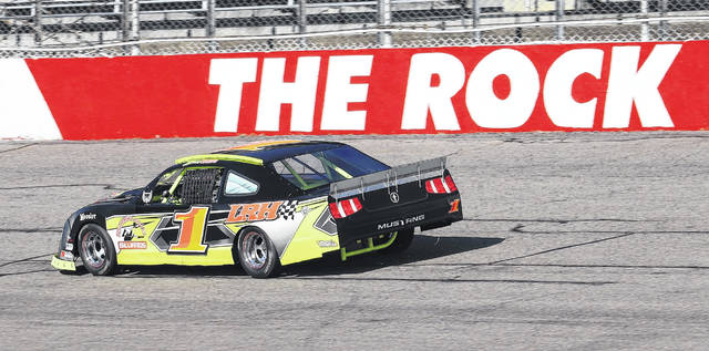 Late model stock cars race around the track at Rockingham Speedway during the initial round of tire testing in December.                                  Neel Madhavan | Daily Journal File Photo