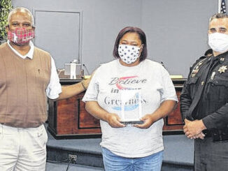 Courtesy photo                                  Scotland County Schools bus driver Felisa McKeithan was honored Monday night during the Scotland County Board. McKeithan received recognition by Scotland County Sheriff's Office Capt. John Hunt for her quick thinking during a bus accident on Aug. 26, 2021. McKeithan was driving Bus 38 was driving south on Hwy. 401 when a vehicle entered their lane of traffic and struck the bus. Hunt gave McKeithan an award from the Scotland County Sheriff's Office honoring her for her passion and commitment to the children in the county. Board member Tony Spaulding also presented the award.